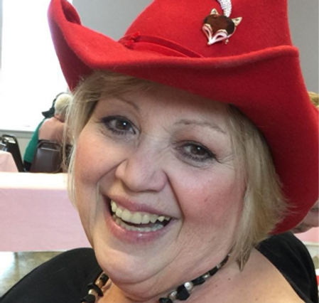 kathi in red hat.png