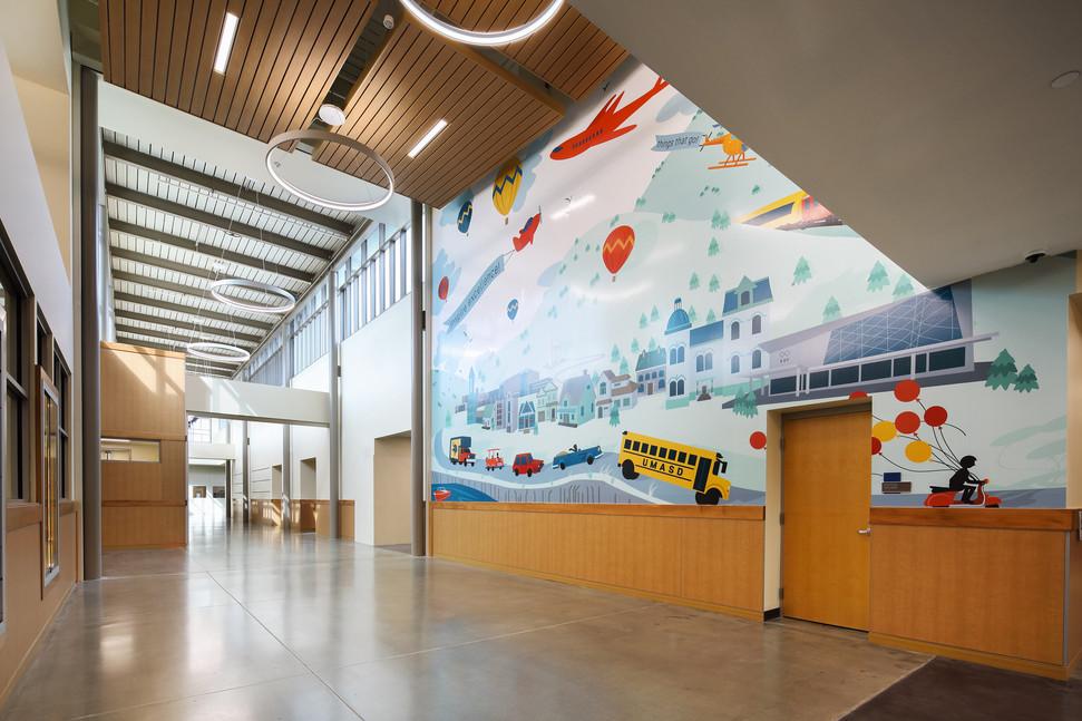 Vinyl Graphic mural installed in two sister elementary schools in Upper Merion Area School District. Photo by Matt Wargo.