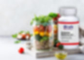 Image of fresh vegetables in jar and plate on cutting board with Guy's Diabetes Balance (RF) white bottle