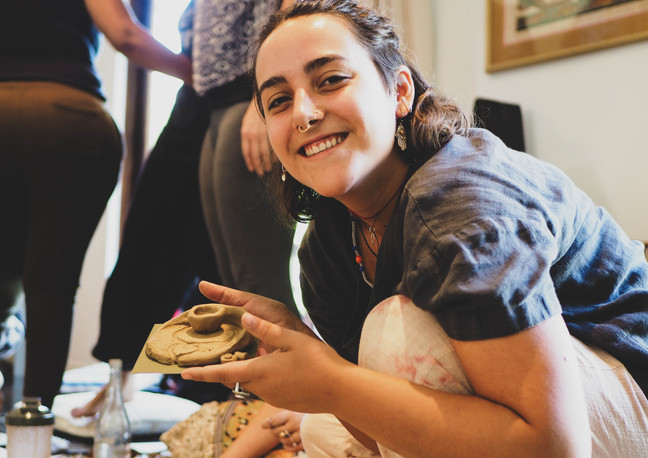 """Smiling lady at """"Connect with self through clay and art workshop"""" Bodhi Breathwork and Yoga, Hout Bay, Cape Town, South Africa"""