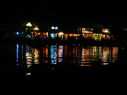 Reflection in the water of colorful town lights in Hoi An, Vietnam