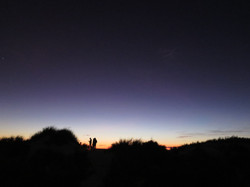 Two people in the dunes during sunset at Western Australia