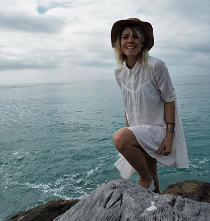 Anouk owner of soul expression smiles near the ocean in Struisbaai, South Africa