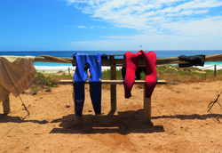 Red Bluff wetsuits drying at the ocean, Western Australia