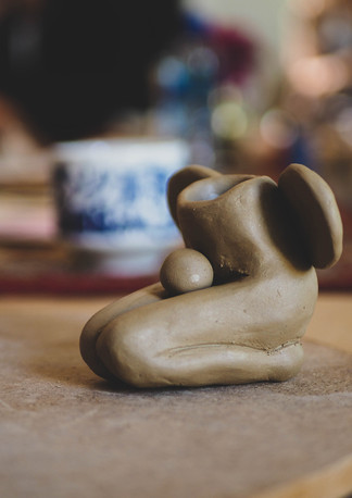 """Womans body clay artwork during """"Connect with self through clay and art workshop"""" Bodhi Breathwork and Yoga, Hout Bay, Cape Town, South Africa"""