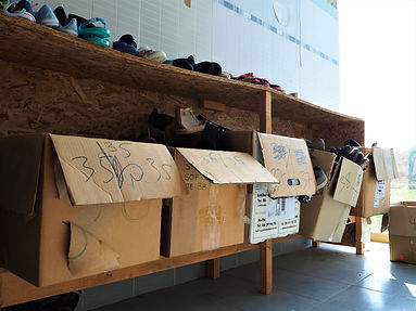 Sorting shoes in Attika, warehouse for refugees in Lesvos, Greece