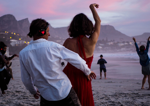 Dancing couple at Conscious Beach Dance at Clifton 1, Cape Town