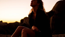 Beautiful woman at sunset between rocks in nature, Llundadno, Cape Town