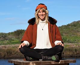 Blonde pretty girl smiles yoga meditation cross legged