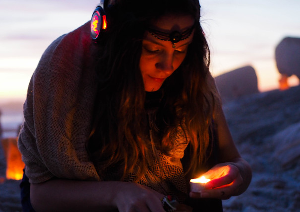 Hippie Gypsy with candle at Conscious Beach Dance at Clifton 1, Cape Town