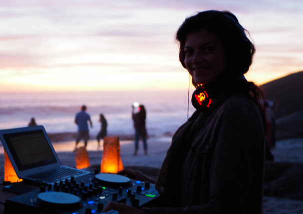 Smiling DJ nadia at Conscious Beach Dance at Clifton 1, Cape Town