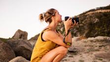Hippie photographer between rocks in nature, in  Llundadno, Cape Town