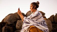 Spiritual Woman holding crystal at sunset, Llundadno Beach, Cape Town