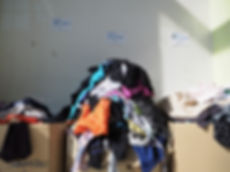 Sorting clothes in Attika, warehouse for refugees in Lesvos, Greece