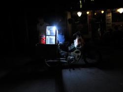 Vendor of sausage at night in Hanoi, Vietnam