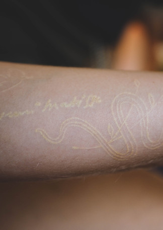 """White snake tattoo at """"Connect with self through clay and art workshop"""" Bodhi Breathwork and Yoga, Hout Bay, Cape Town, South Africa"""