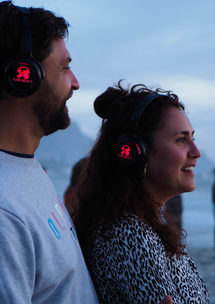 Happy couple with headsets at Conscious Beach Dance at Clifton 1, Cape Town