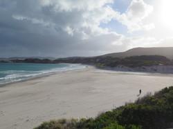 Misty empty beach with one person Western Australia