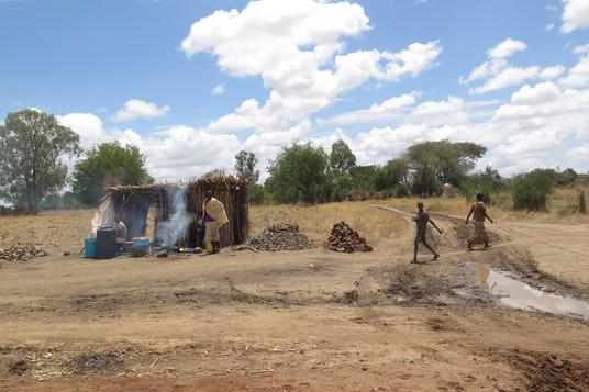 Karamajong and houses in Karamoja, Uganda