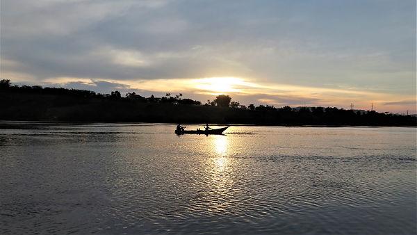 Sunset with a boat on the Nile near Jinja, Ugana