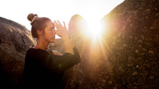 Namaste in front of third chakra, spirituality at sunset in  Llundadno, Cape Town