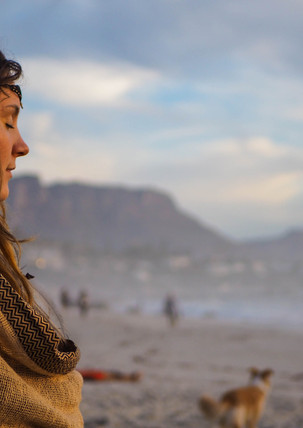 Hippie in meditation at Conscious Beach Dance at Clifton 1, Cape Town