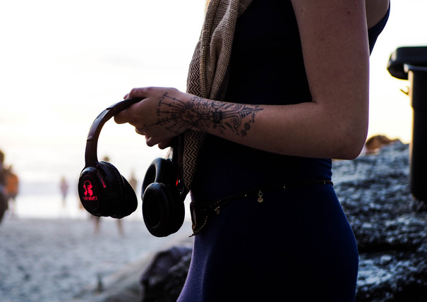 Headset and tribal tattoo at Conscious Beach Dance at Clifton 1, Cape Town