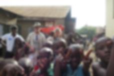 Me and African children in Katanga slum, Kampala, Kotido