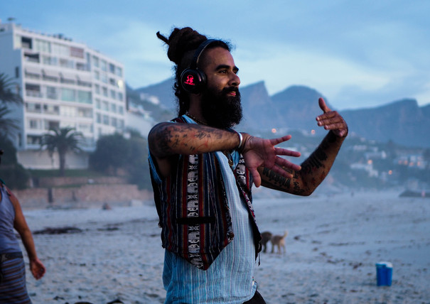 Dancing hippie, gypsy at Conscious Beach Dance at Clifton 1, Cape Town