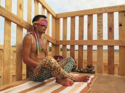 Guy meditating in color