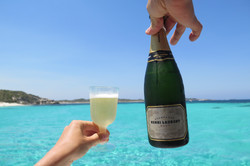 Champagne at the crystal clear ocean