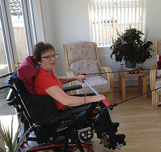 Lady in wheelchair doing exercise