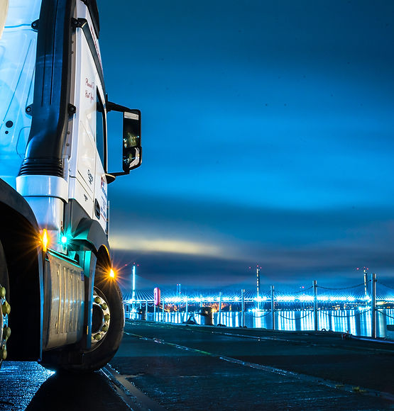 Mercedes Actros Truck at night next to the Firth of Forth, Edinburgh