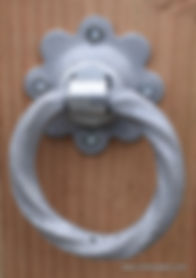 Twisted ring Latch handle