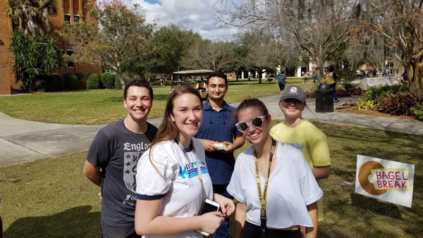 Students at Bagel Break at the Reflection Pond