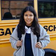 school girl in front of bus.jpg