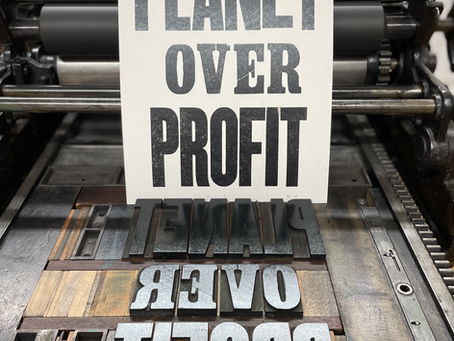 Planet Over Profit Poster