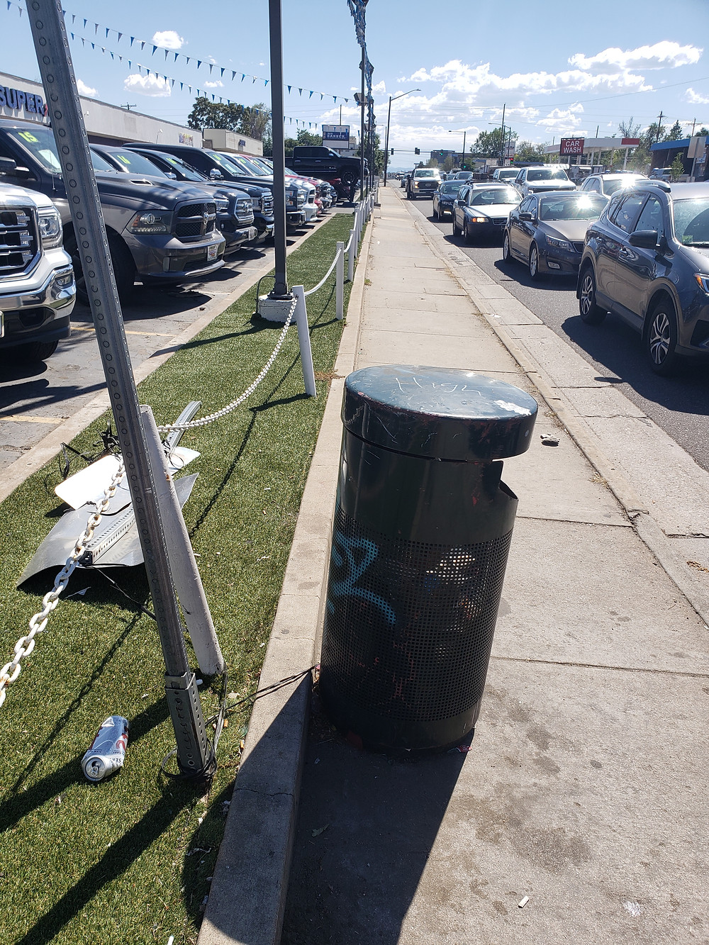 A bus stop pole with no amenities right next to oncoming traffic