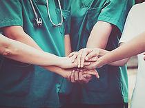 Doctors and nurses coordinate hands. Con