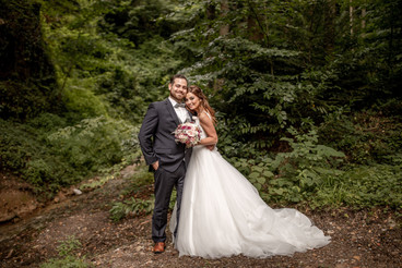 Stunning elopement, engagement, wedding photos in front of trees in a forest