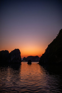 beautiful play of colors at the night sky over Halong Bay in Vietnam