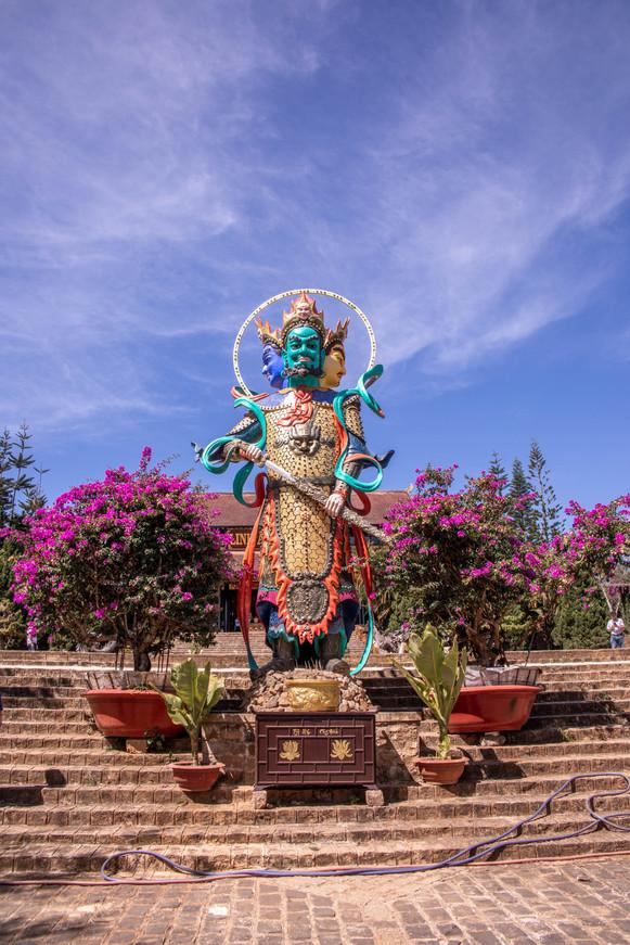 Statue by a buddhistic temple in Dalat in Vientam