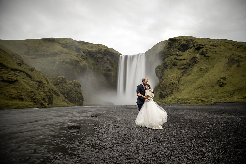 Elopement photos in front of the famos waterfall Skogafoss in Iceland adventure Elopements and intimate weddings Iceland weddingphotographer