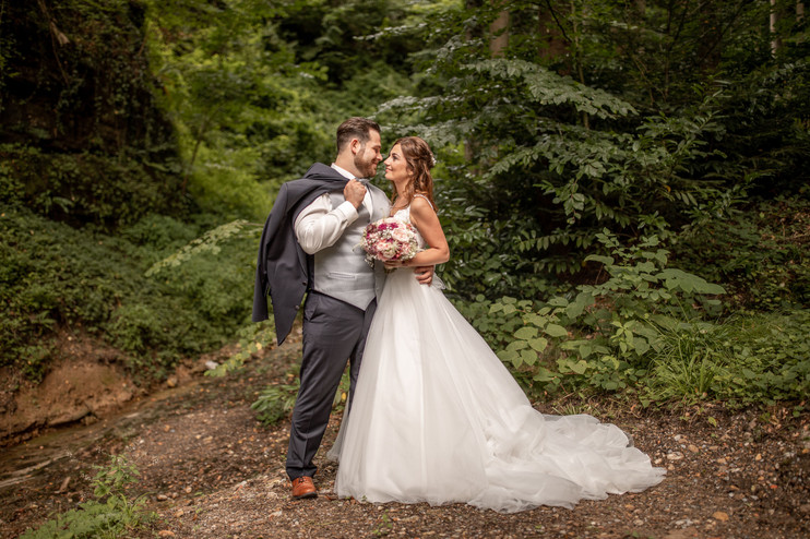 beautiful bridal couple on a after wedding shooting in the forest