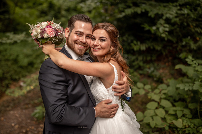 bridal couple portrait photo in the forest - happy newly married couple