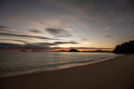 Sunset on a sand beach in the philippines