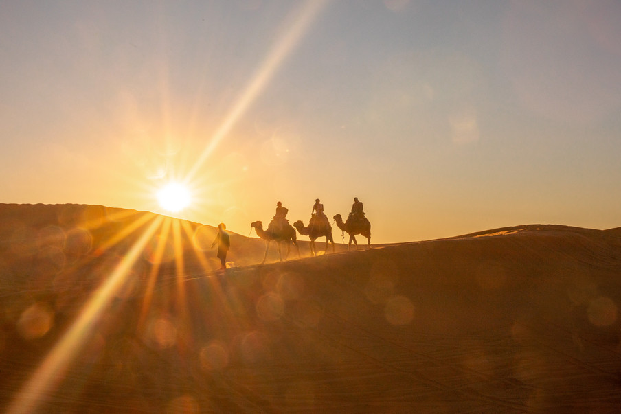 Camel ride by sunset in the Sahara desert | Travel and Landscape Photography in Morocco Africa || Bohoray - Adventure Elopement and Wedding Photographer - Victoria Ruef || www.bohoray.com