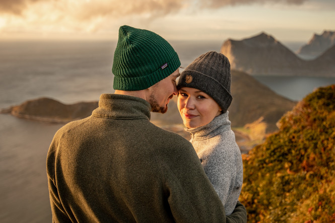 couple photos on a mountain in the lofoten