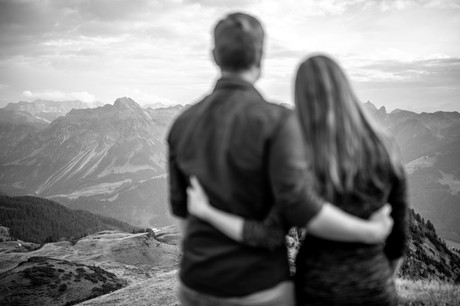 epic black and white couple photo in the mountains in austria