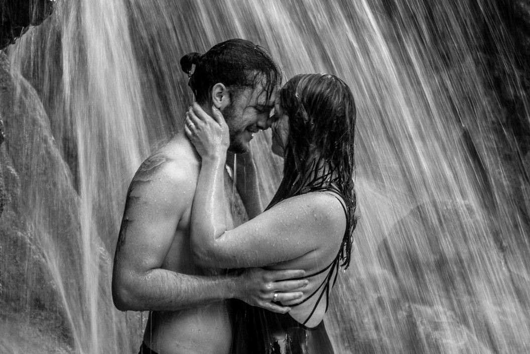 black and white couple photos under a waterfall - photographer in croatia
